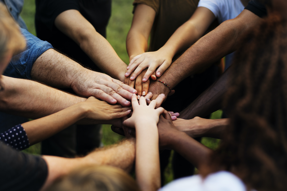 Group of people with their hands together